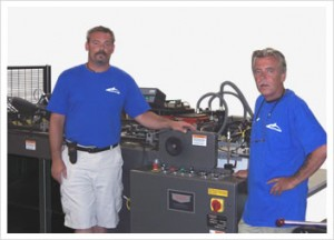Pictured: Jim Lemmer, V.P. of Production (left), 48hourprint.com and Charles Watson, Operator, 48hourprint.com (right).
